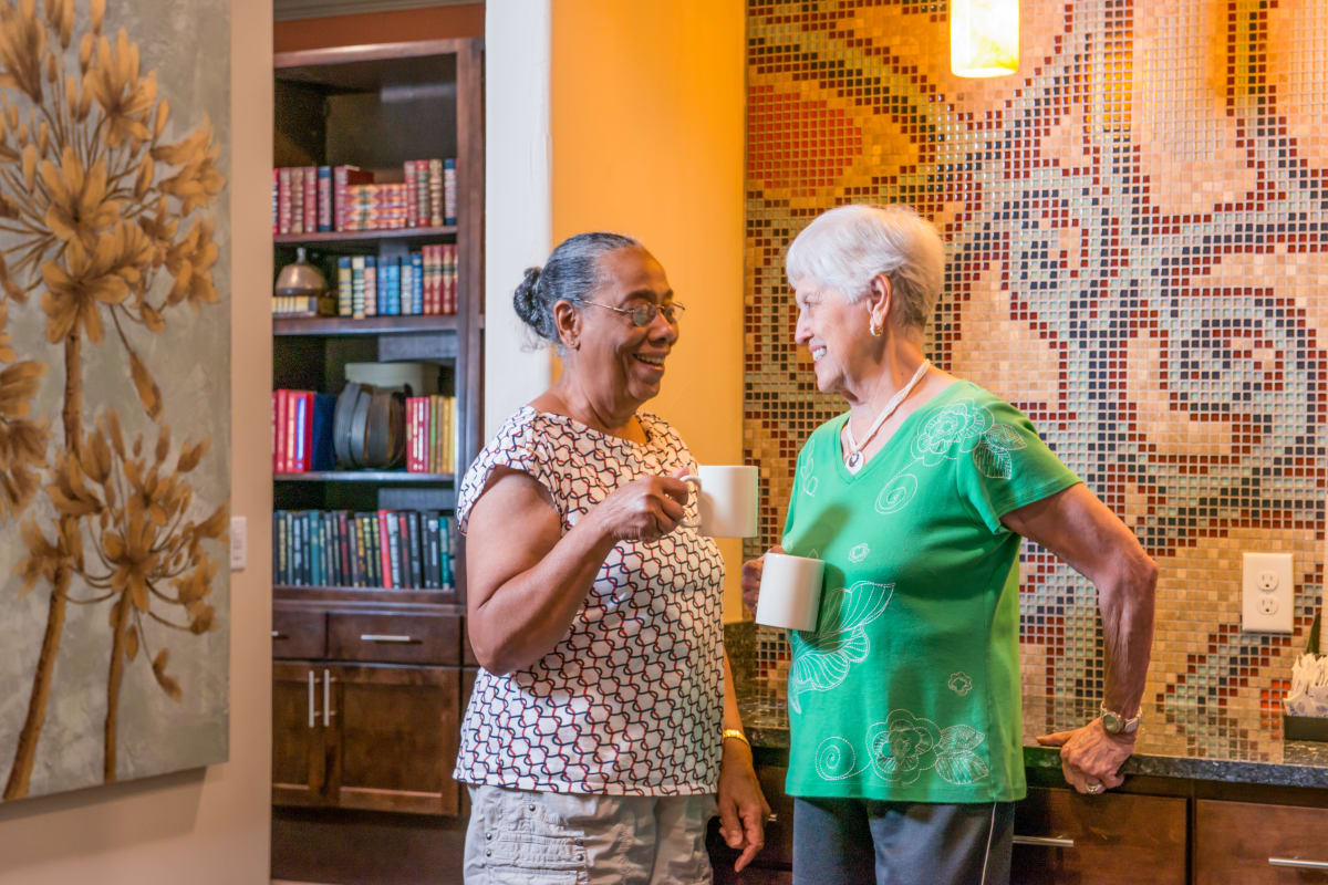 Residents chatting at an Integrated Senior Lifestyles community