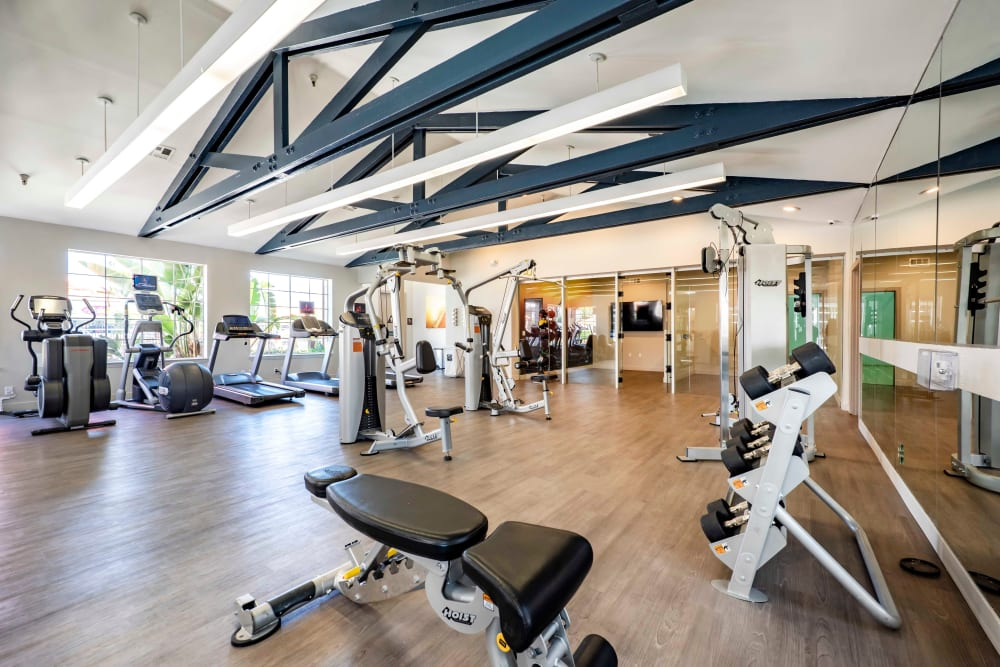 Fitness center with plenty of individual workout stations at Sierra Del Oro Apartments in Corona, California
