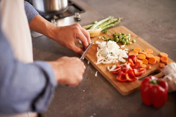 resident chopping vegetables at Veranda in Texas City, Texas