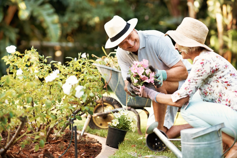 Seniors working in the garden at Watermere at Flower Mound in Flower Mound, Texas