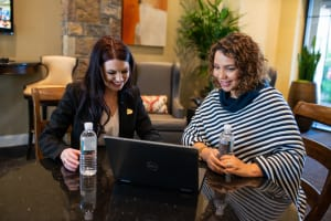 Leasing consultant assisting a prospective resident at a Mark-Taylor community