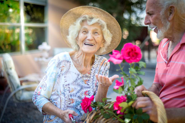 Happy residents gardening at Randall Residence of Encore Village in Brighton, Michigan