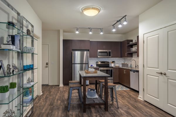 Kitchen with island and hardwood floors in model home at Capital Place in Phoenix, Arizona