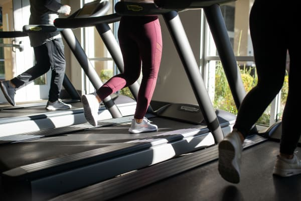 Residents running on the treadmills in the fitness center at The Hyve in Tempe, Arizona
