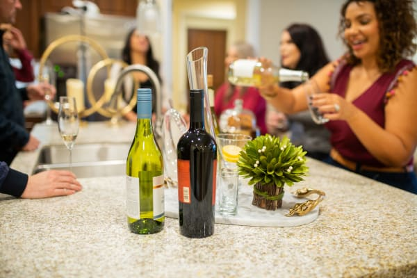 Residents enjoying drinks with friends in their new home at Remington Ranch in Litchfield Park, Arizona