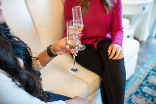 Residents enjoying champagne in their new home at San Hacienda in Chandler, Arizona