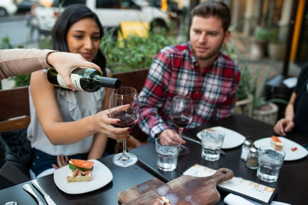 Residents enjoying dinner and drinks near San Prado in Glendale, Arizona