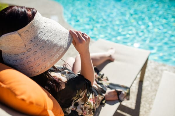 Resident relaxing near the pool at Stone Oaks in Chandler, Arizona
