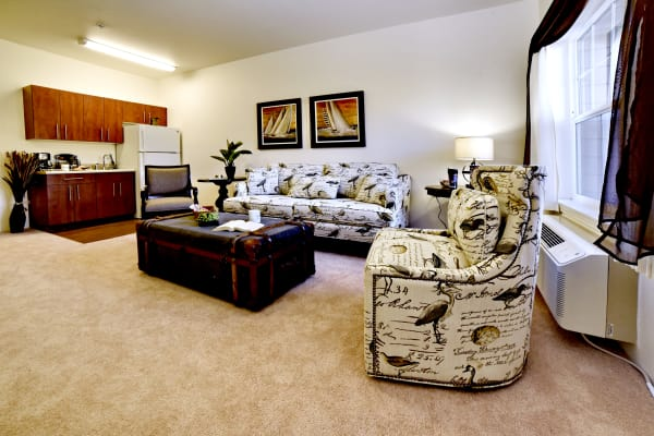 Living room leading to the dining room at Paloma Landing Retirement Community in Albuquerque, New Mexico