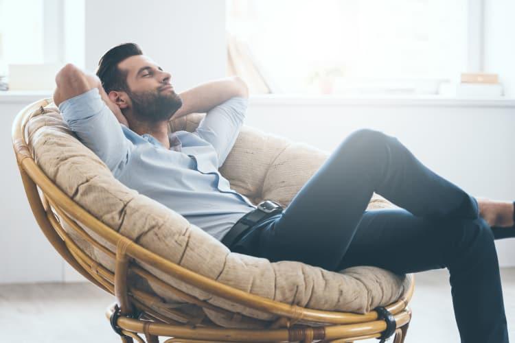 Man relaxing in comfortable chair at Forum at Grand Prairie in Grand Prairie, Texas