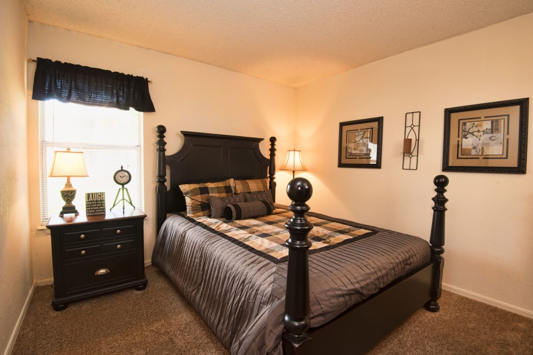 Master bedroom at Aspen Park Apartments in Wichita, Kansas