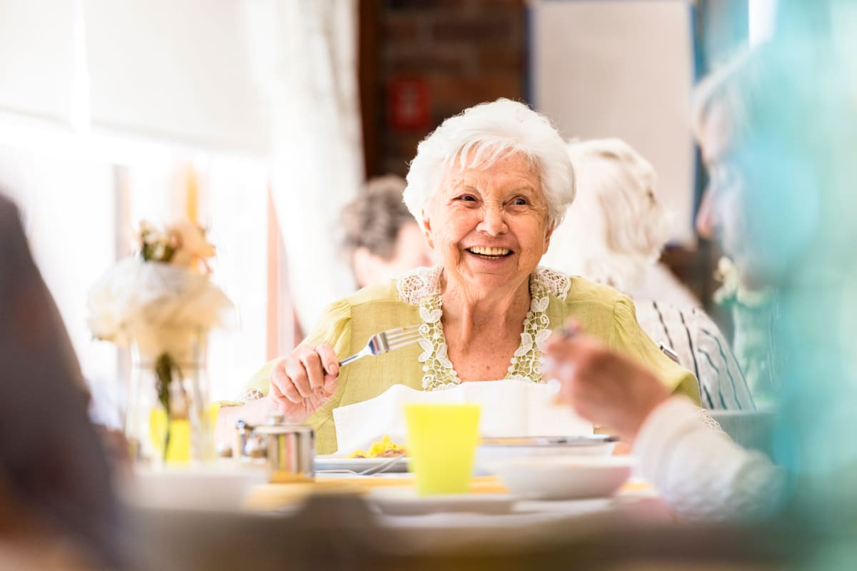 Resident smiling at the breakfast table at Brentwood at LaPorte in La Porte, Indiana