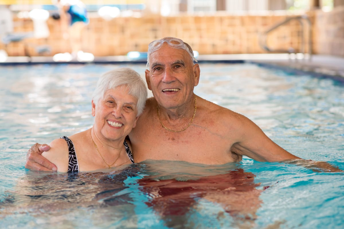Couple enjoying the swimming pool at Watercrest at Bryan in Bryan, Texas