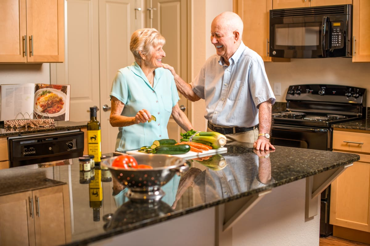 Resident couple in their kitchen at Watermere at Flower Mound in Flower Mound, Texas