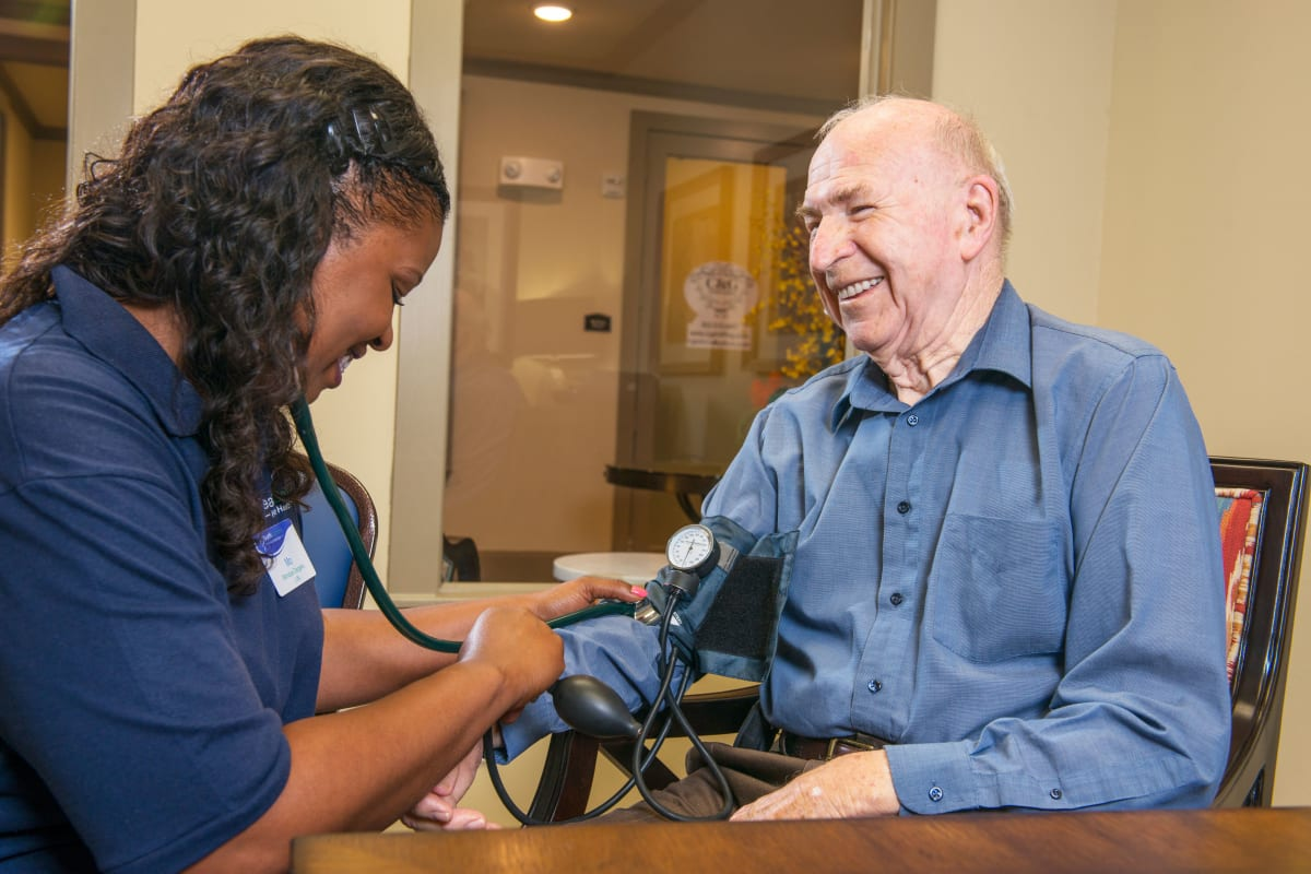 Resident being assisted by a staff member at an Integrated Senior Lifestyles community