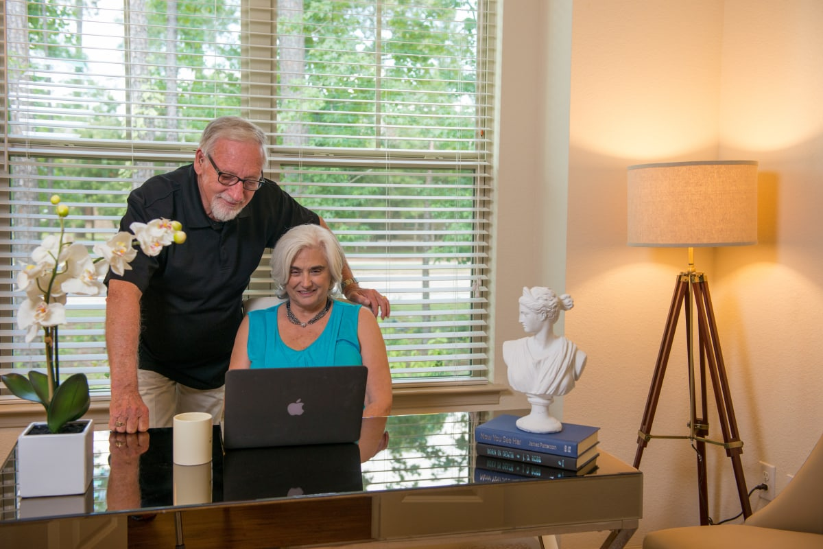 Residents on a computer at Landing at Watercrest Shadow Creek Ranch in Pearland, Texas