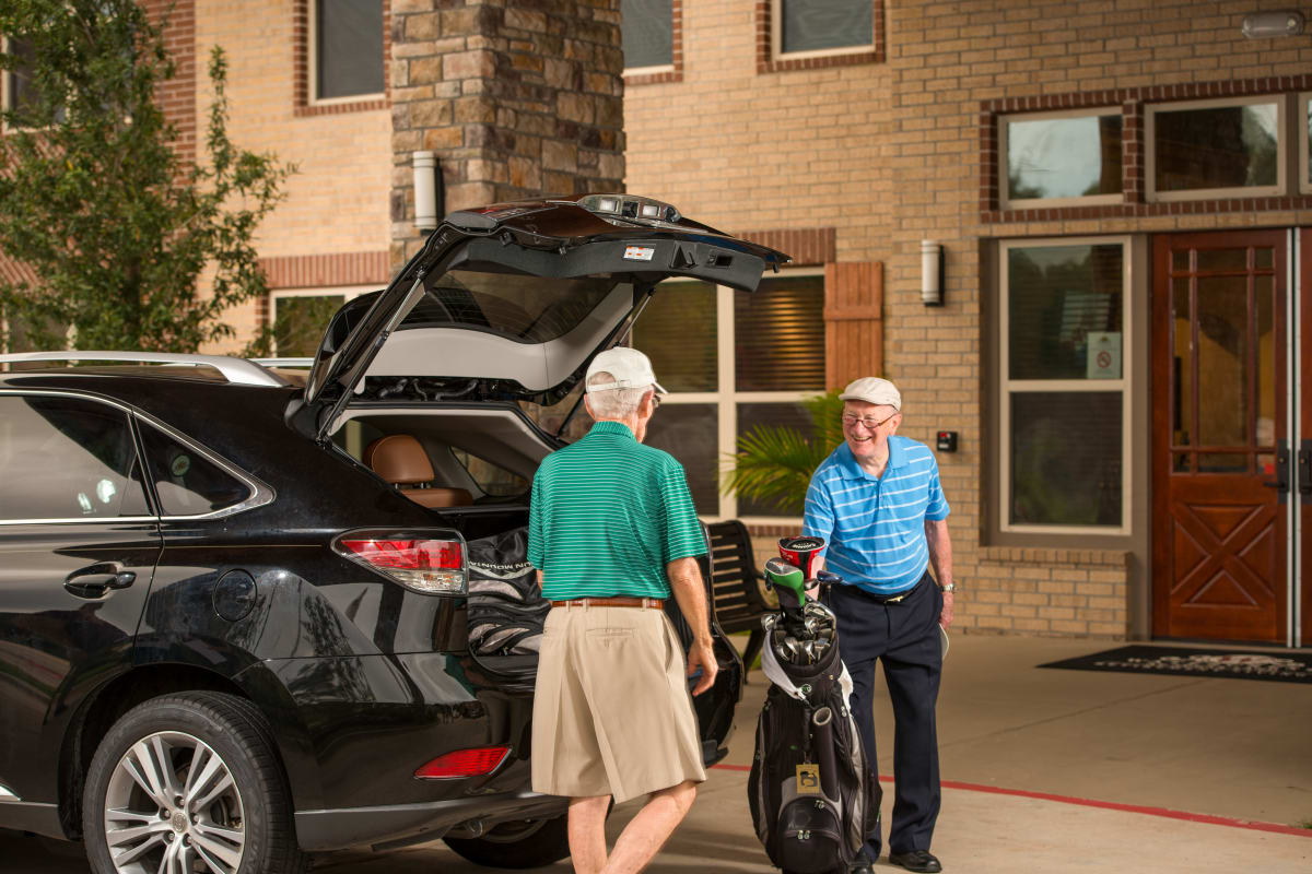 Residents of a Integrated Senior Lifestyles community getting out for a golf game.
