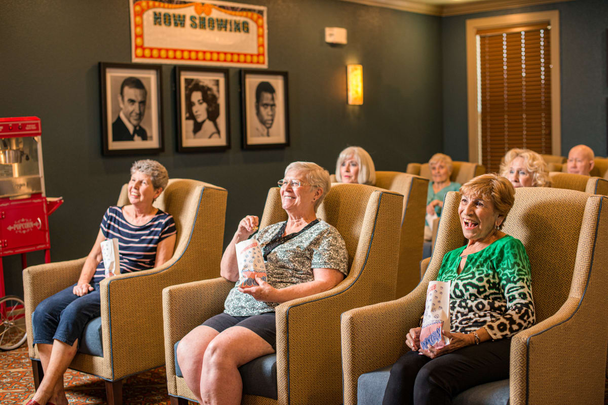 Residents enjoying a movie at an Integrated Senior Lifestyles community
