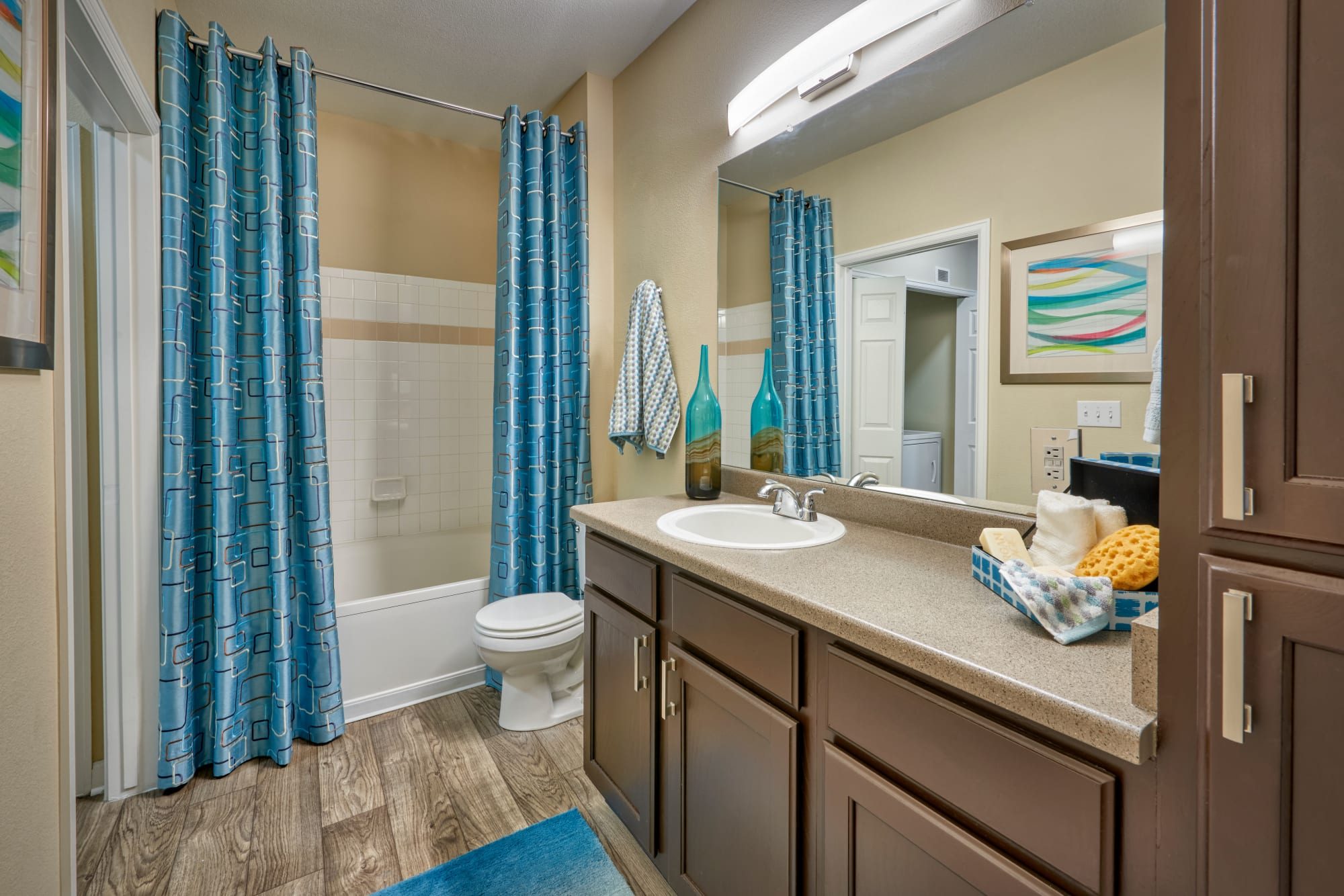 Bathroom with a tub at Skyecrest Apartments in Lakewood, Colorado
