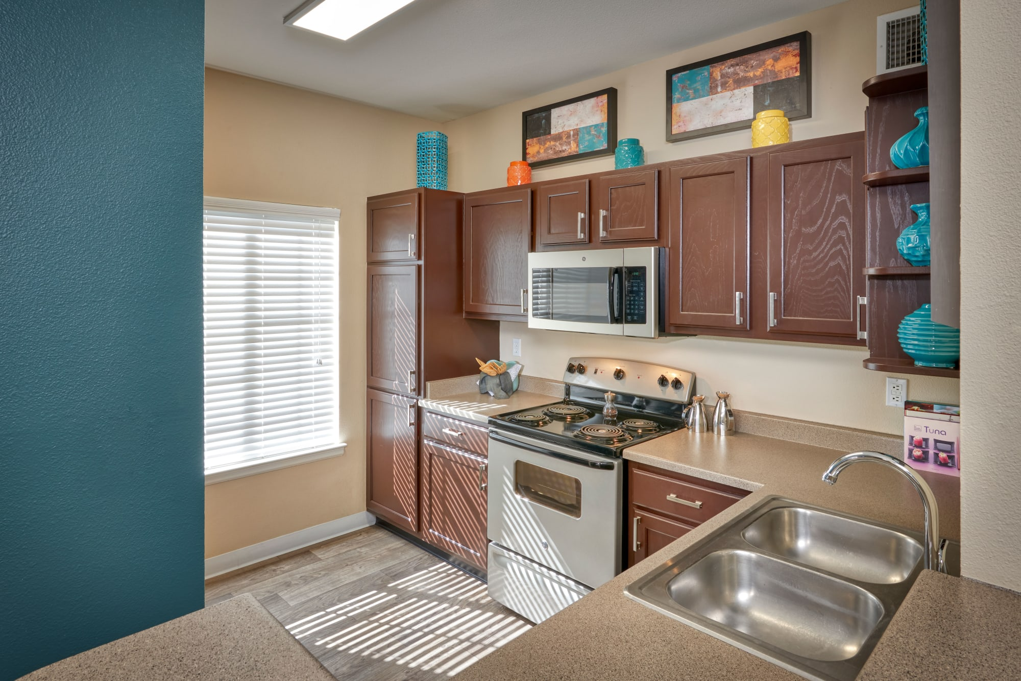 Renovated kitchen with espresso cabinets at Skyecrest Apartments in Lakewood, Colorado