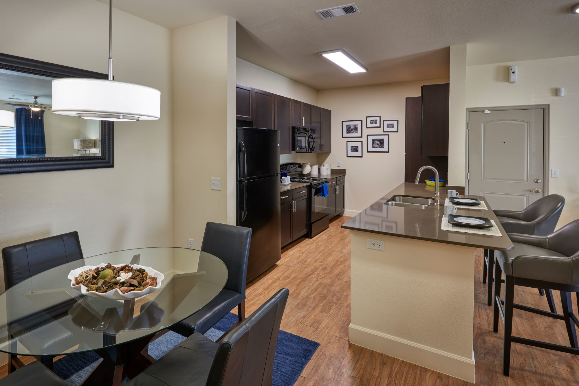 Kitchen, dining area, and living room are connected in this open floor plan at M2 Apartments in Denver, Colorado