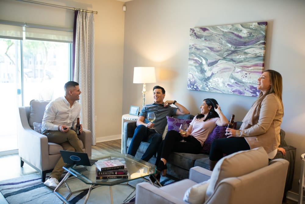 Residents enjoying their brand new spacious living room at The Astor at Osborn in Phoenix, Arizona
