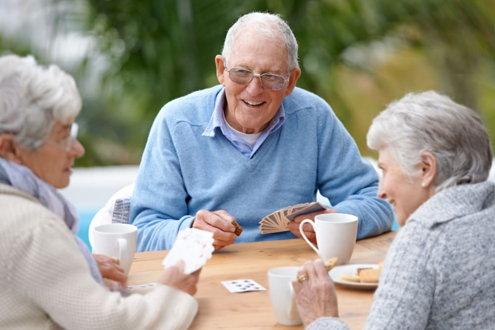Residents enjoy playing cards outdoors at Willows Landing in Monticello, Minnesota.