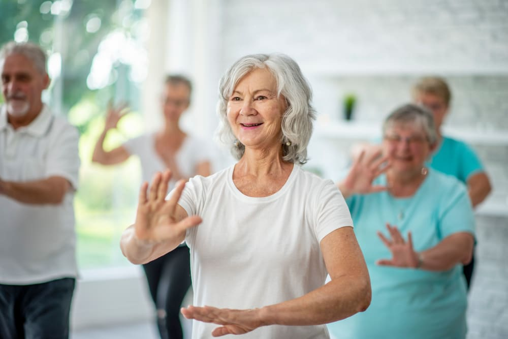 A resident in a wellness class at CERTUS Premier Memory Care Living.