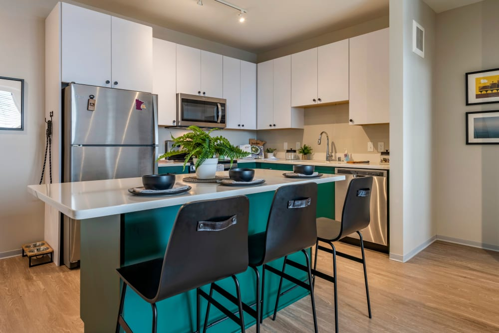 Spacious kitchen with stainless steel appliances at UNCOMMON Dinkytown in Minneapolis, Minnesota