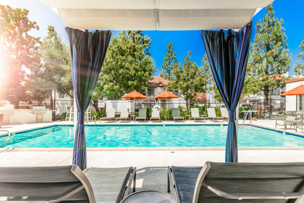Resort-style swimming pool and sundeck at Sonora at Alta Loma in Alta Loma, California