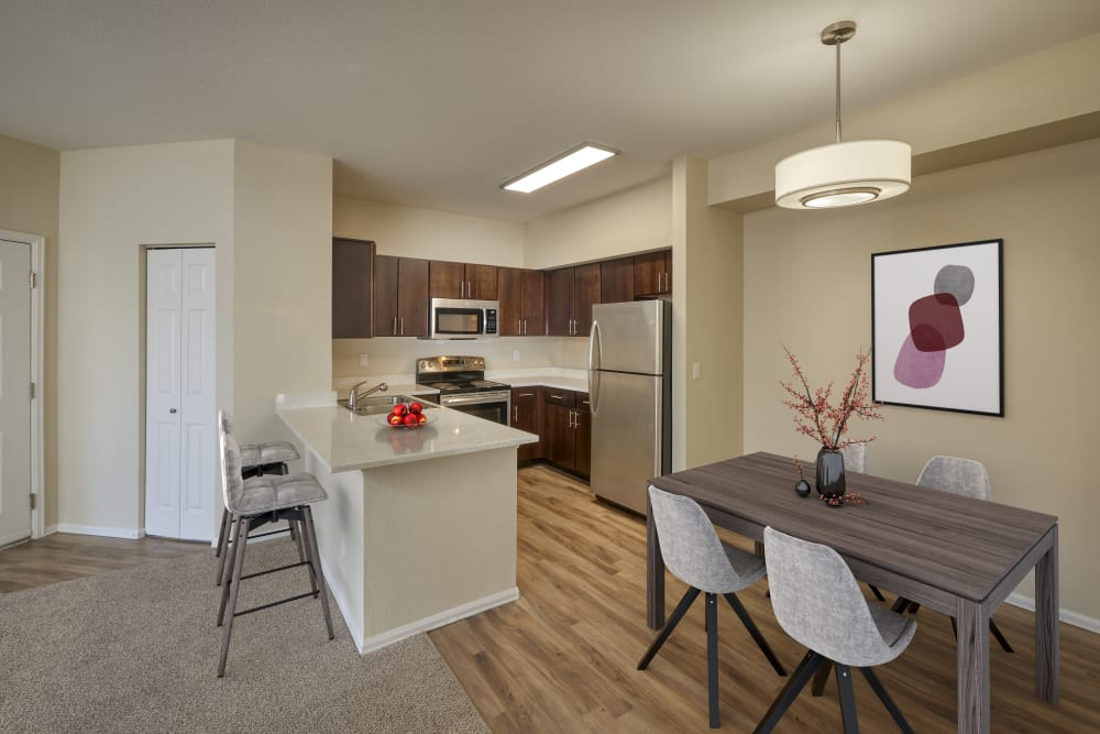 A kitchen with plenty of cabinet space at The Crossings at Bear Creek Apartments in Lakewood, Colorado