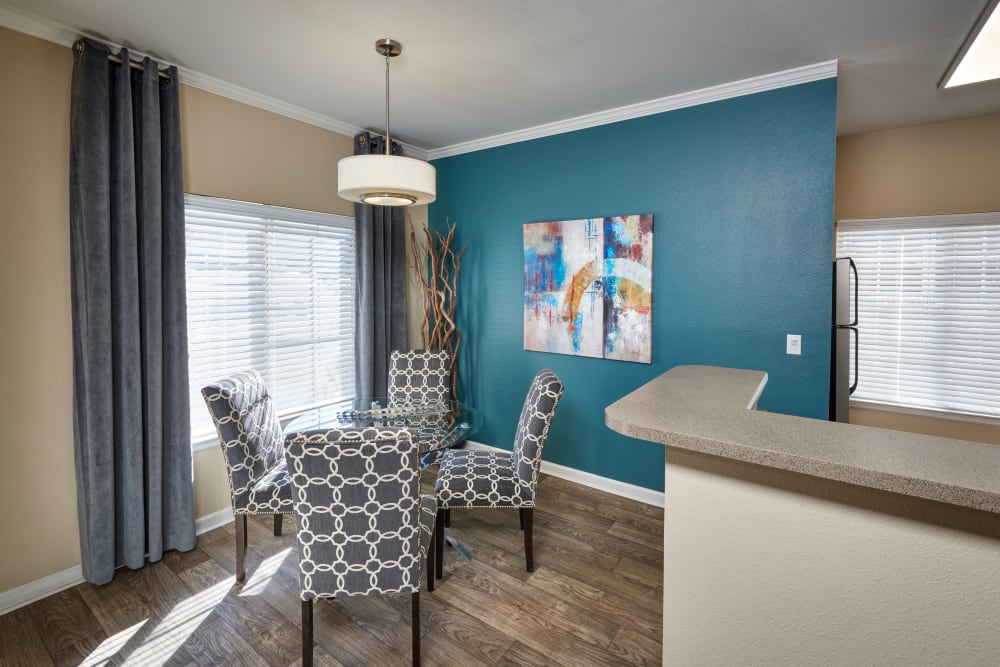 A sunny dining room at Skyecrest Apartments in Lakewood, Colorado