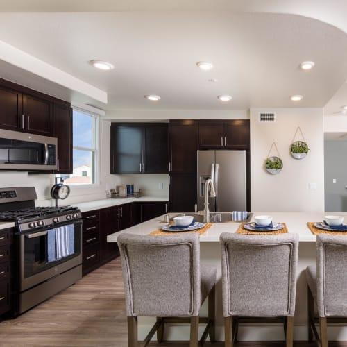 Spacious open-concept kitchen in a model home at Portside Ventura Harbor in Ventura, California