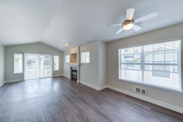 Hard wood floors and fireplace in model apartment home at Bradley Park Apartments