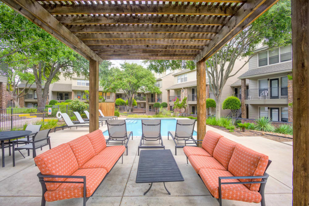 Rest area and swimming pool at Enclave at Water's Edge Apartments in Austin, Texas