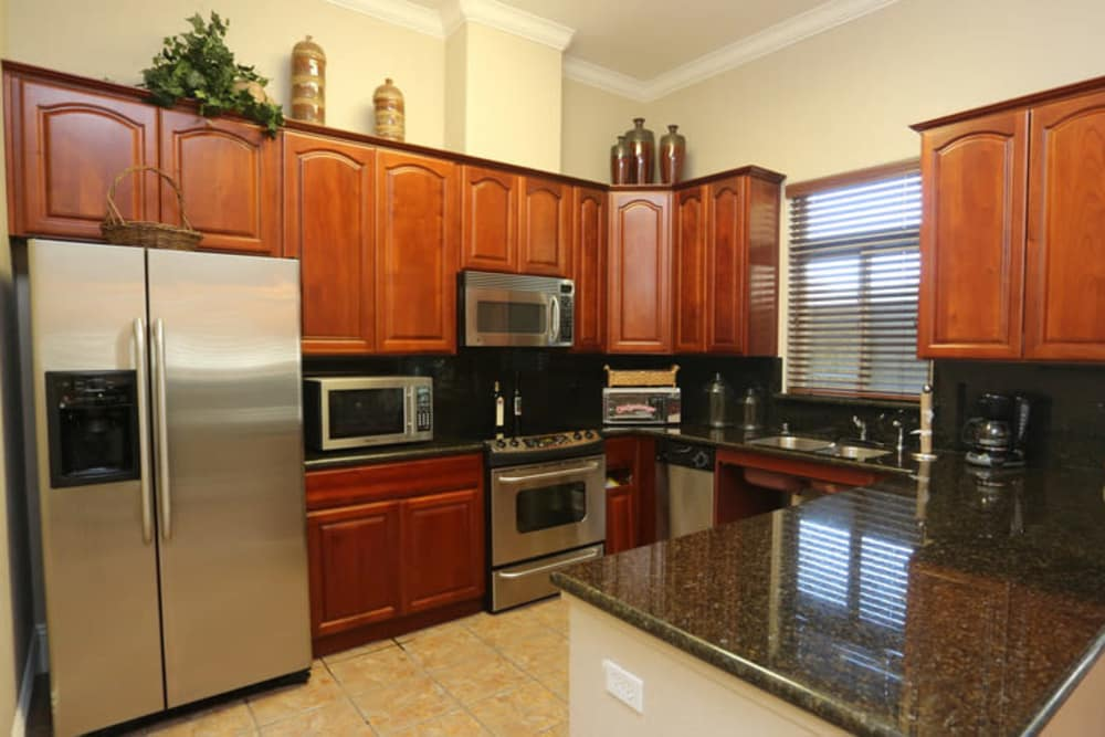 Modern kitchen with wooden cabinetry at Wolf Ranch Condominium Rentals in Sacramento, California