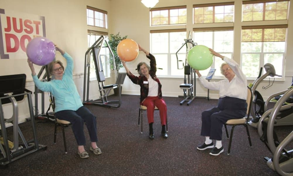 Residents in the exercise room at Alexis Estates Gracious Retirement Living in Allen, Texas