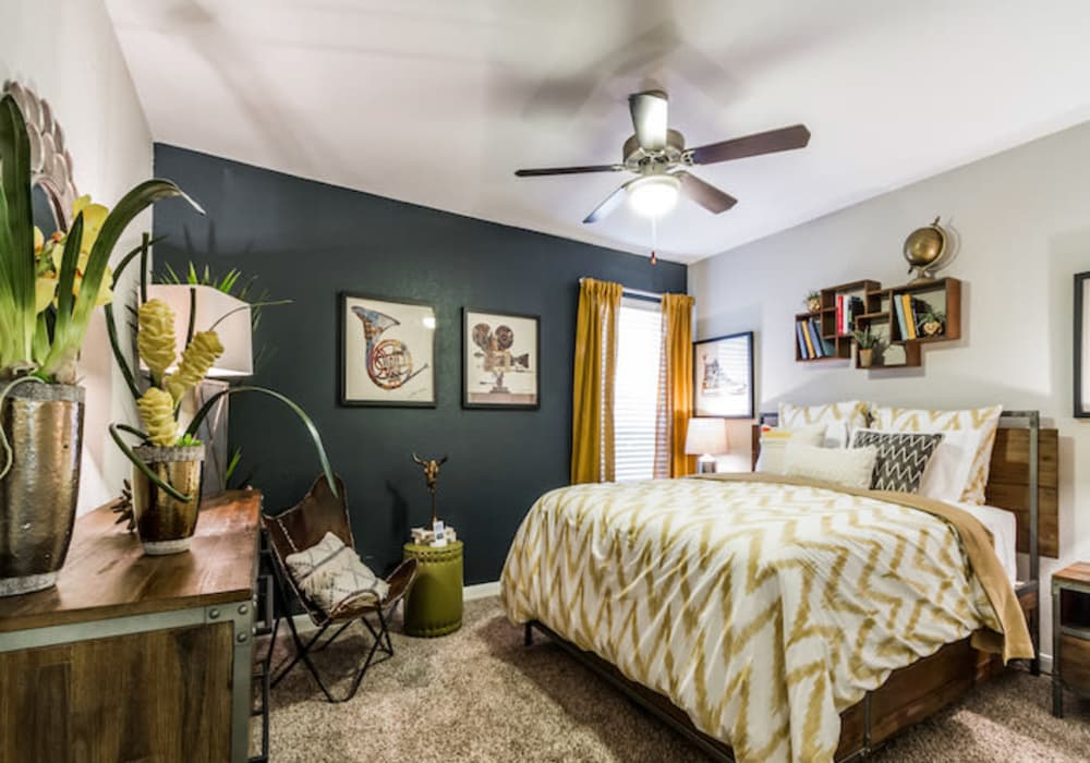 Well decorated bedroom at 2400 Briarwest in Houston, Texas