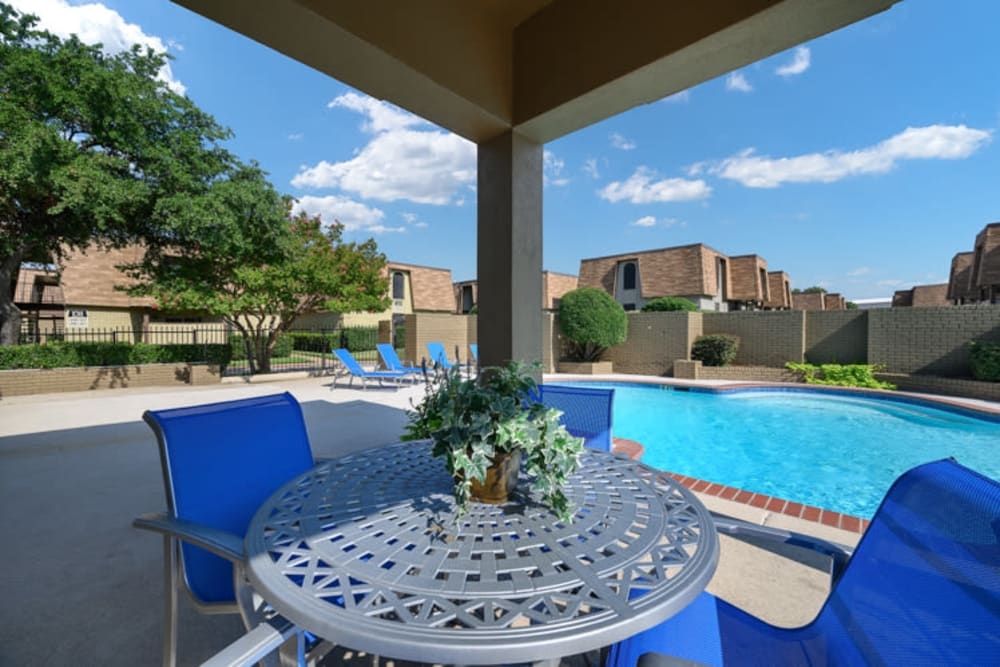 Poolside seating at The Manchester Apartments in Euless, Texas