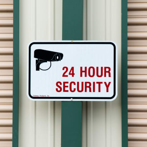 Sign for 24-hour security cameras at Red Dot Storage in Mobile, Alabama