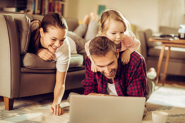 Family surfing the web in their beautiful living room at Brookview Manor Apartments in Stratford, New Jersey