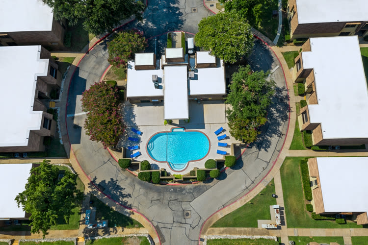 Aerial view of the pool at The Manchester Apartments in Euless, Texas