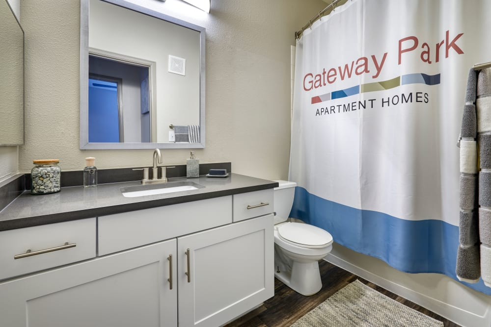 A bathroom with plenty of cabinet space at Gateway Park Apartments in Denver, Colorado