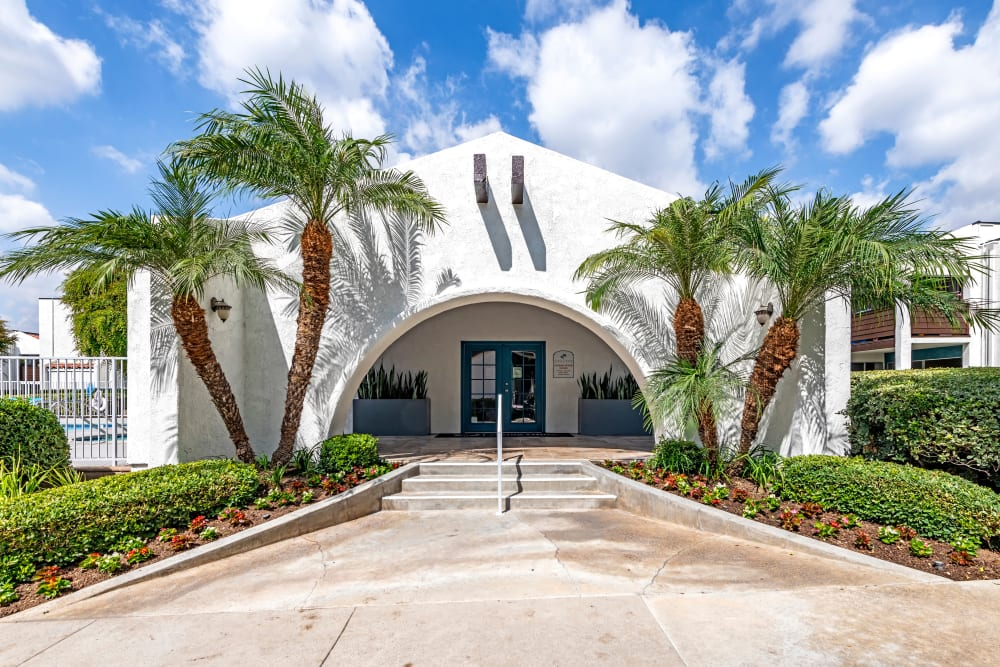 The leasing office entryway surrounded palm trees at Kendallwood Apartments in Whittier, California