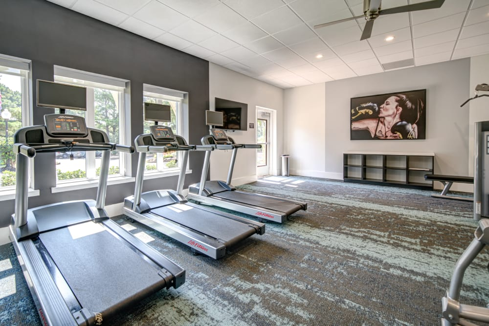 A spacious gym with a ceiling fan at Waterview Apartment Homes in Memphis, Tennessee