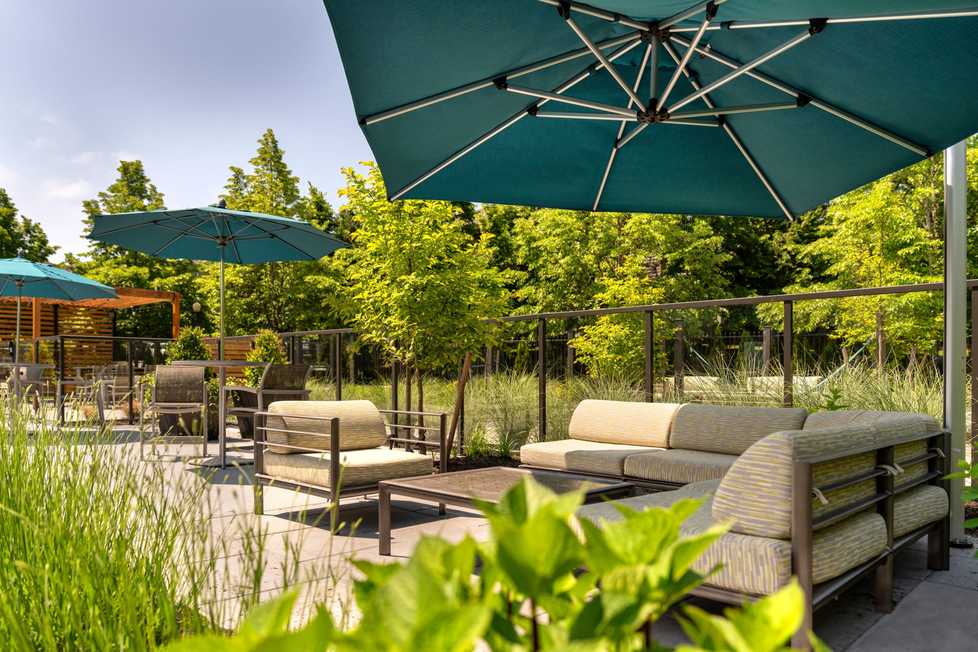 Covered lounge seating, poolside at Brookside Village in Auburn, Washington