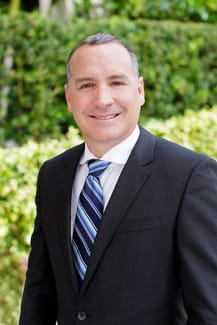 JOSEPH A. ROIG, VICE PRESIDENT OF CONSTRUCTION