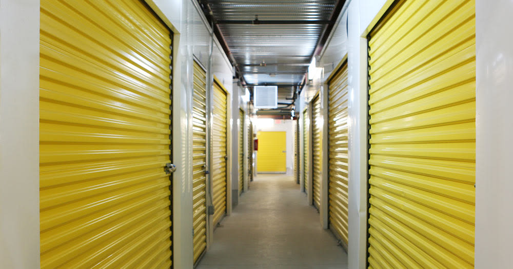 Storage units with yellow doors at Midgard Self Storage in Greenwood, South Carolina