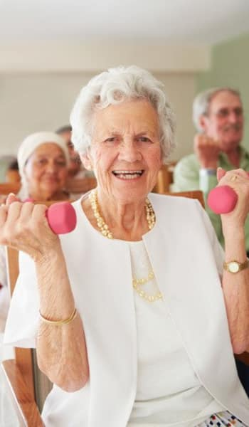 Resident exercising with weights at The Phoenix at Johnson Ferry in Marietta, GA