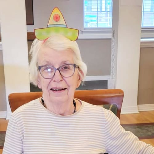 Resident with a fun hat at Homestead House in Beatrice, Nebraska